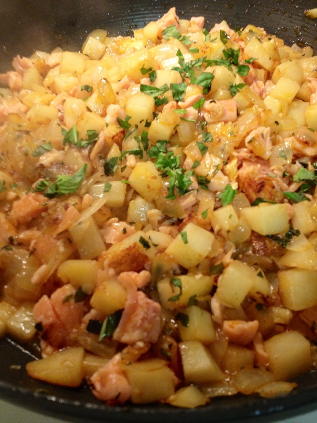 Here we are with the fried potatoes, onion, garlic, basil, and smoked salmon.  Right now I'm letting it sit to get a little crispy and browned.