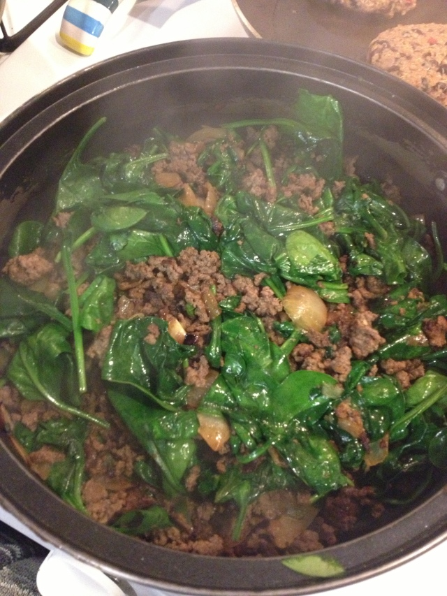 Stir the spinach until it becomes slightly wilted, and then add the eggs.