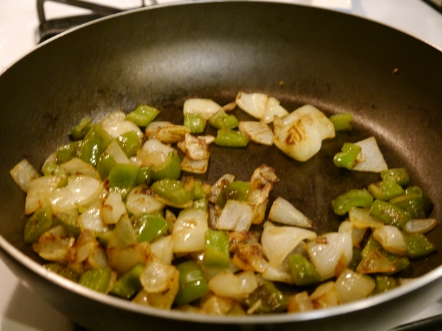 Cookin' up the pepper and onion.