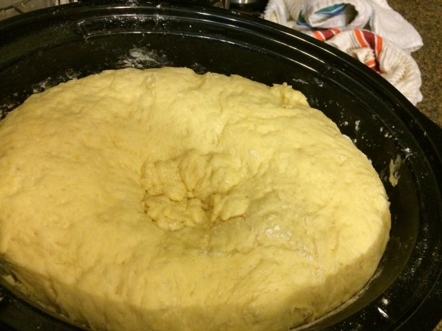 This is after the second time you let the dough sit.  (After first stirring, and after adding melted butter and extra flour)... now it's on to making rolls!